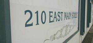 210 East Main Street sign