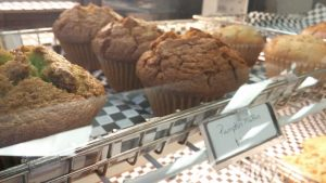 Muffins in coffee shop case