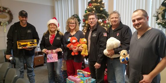 Representatives from the Cattaraugus County Town Highway Superintendents Association present gifts for the youngest emergency department patients at Bertrand Chaffee Hospital